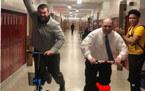 Mr.Woodhull and Mr.Kane are no longer injured but they miss their scooters .  A picture of Mr.Woodhull & Mr.Kane daily races with Jesus Cabrera cheering.