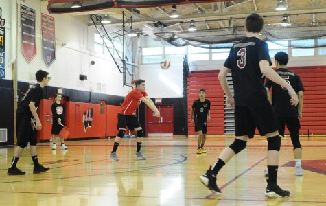 The boys' volleyball team warms up for a scrimmage against Piscataway. The Barrons worked hard in the preseason with intentions of having a successful regular season.