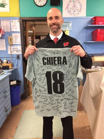 Mr. Chiera poses with a special parting gift from the staff at WHS. His last official day as vice principal was March 29th.