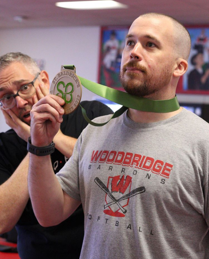 Mr.+O%27Halloran+boasts+his+first+place+medal+for+top+St%2C+Baldrick%27s+fundraiser.+Among+staff%2C+he+raised+over+a+thousand+dollars+in+the+span+of+several+months+to+fight+pediatric+cancer.