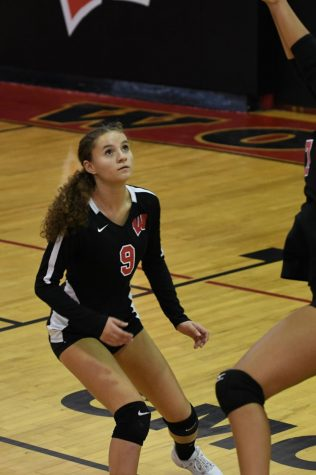 Nicole Bialy gets in position to cover for the hit. The Lady Barrons won the White-Division this year.