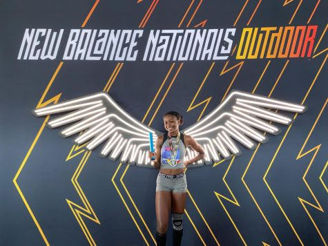 Trinity Eason poses for pictures at New Balance Nationals moments before her race. She has competed in highly competitive races such as nationals and the UPENN relays.
