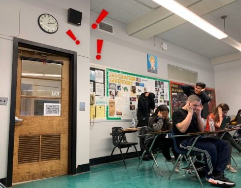 Students clasp their hands over their ears as Ms. Montes loudly runs through the daily announcements. As of recent, Montes was named permanent announcer by the administration.